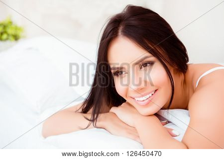 Happy Sexy Girl  Lying On  White Bed And Dreaming