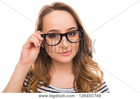 Close Up Photo Of Pretty Smart Girl Touching Her Glasses