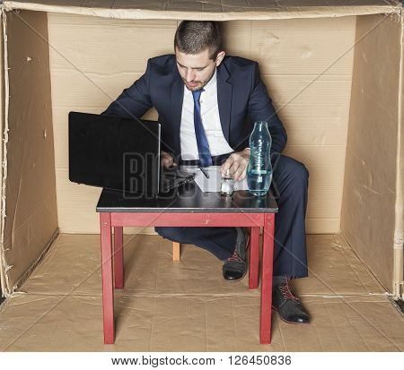 Businessman Working Hard, Alcohol On His Desk