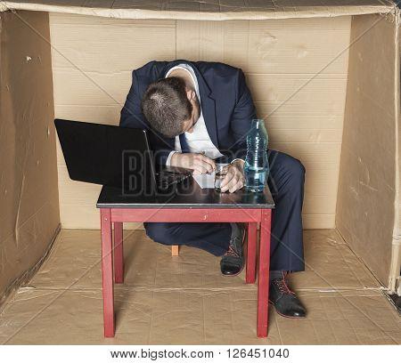 Drunk Businessman Asleep At His Desk