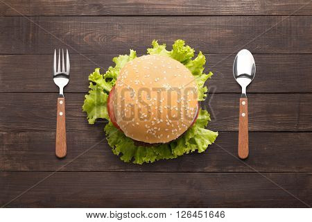 Eating Bbq Burger On The Wooden Background