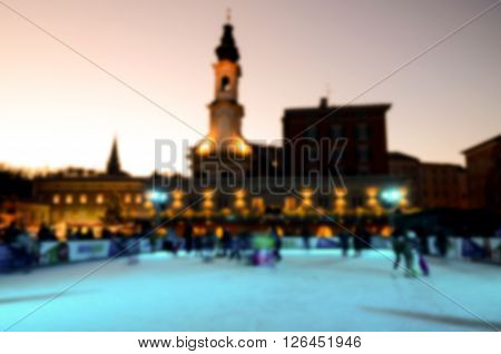 Abstract blur of people skating in the park in evening on winter skating rink Salzburg Austria