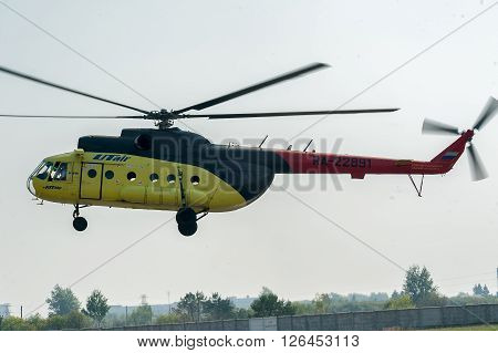 Tyumen, Russia - August 11, 2012: On a visit at UTair airshow in Plehanovo heliport. Passenger helicopter MI-8 landing