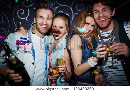 Night clubbers with champagne