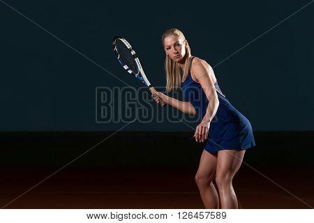 Young Girl Playing Tennis Hitting Ball