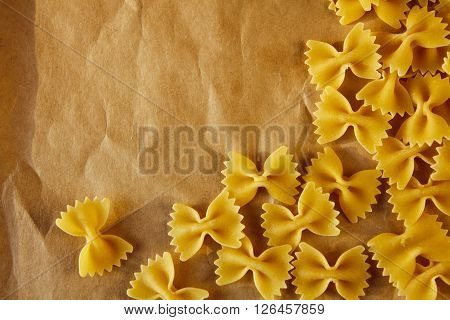 Beautiful Background Made Of Pasta Ribbons On Parchment Paper With Space For Your Text