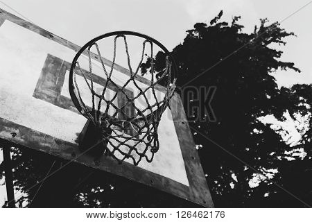 Black and white basketball rim from a park court