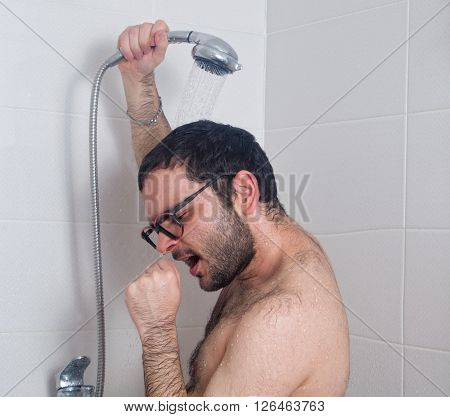 Young bearded man sings in the shower