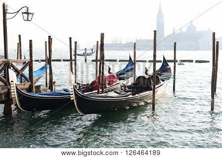 Traditional Gondola on Canal Grande with San Giorgio Maggiore church in the white background San Marco Venice Italy