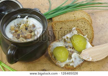 slice of bread with lard on stone background