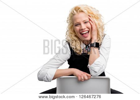 Portrait of happy woman smiling and holding her head