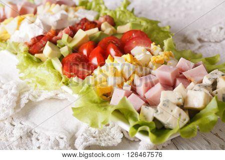 Sliced Cobb Salad Close-up On A Plate. Horizontal