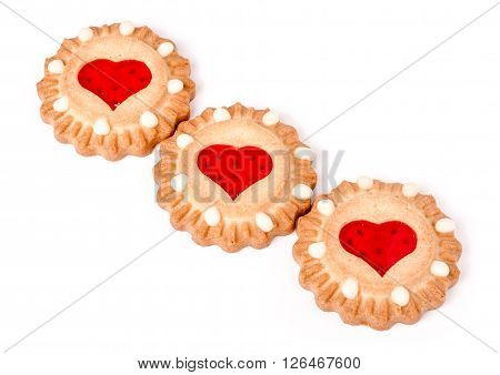 three cookies with marmalade heart isolated on white background.