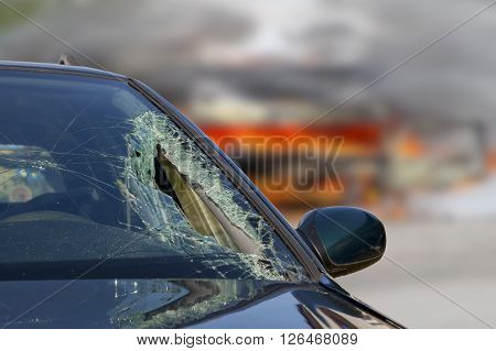 Broken windscreen at black car in traffic accident