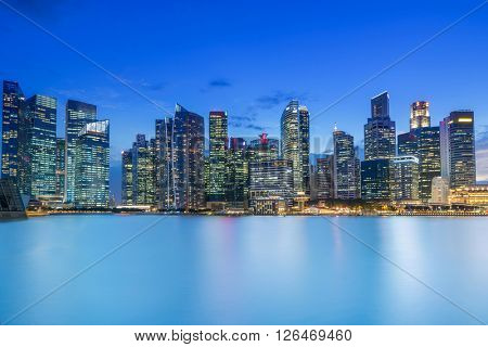 Singapore business district skyline after sun set at Marina Bay.
