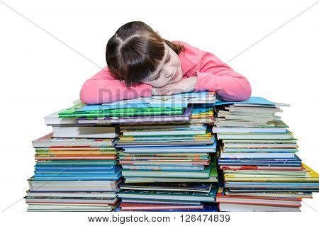 Little girl in a pink jacket sleeps on a pile of book