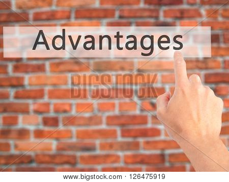 Advantages  - Hand Pressing A Button On Blurred Background Concept On Visual Screen.
