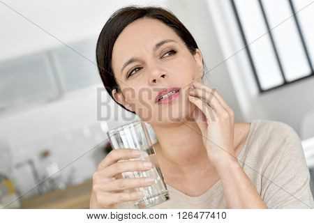 Mature woman having toothache