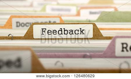 Feedback Concept on File Label in Multicolor Card Index. Closeup View. Selective Focus. 3D Render.