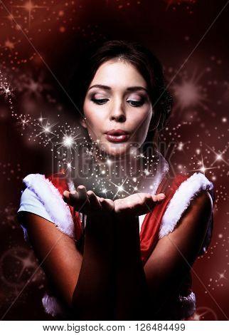 young christmas woman holding magic stars