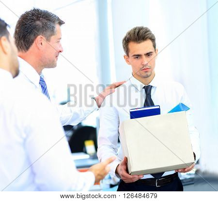 dismissed businessman carrying box