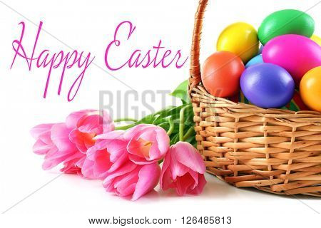Easter greeting card. Multicoloured eggs in basket isolated on white
