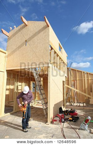 Worker on a site of house under construction