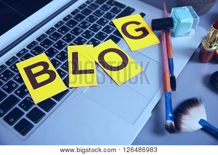 Beauty blog concept Set of fashion accessories and laptop.