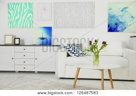 Modern living room interior with white sofa and coffee table on a white background