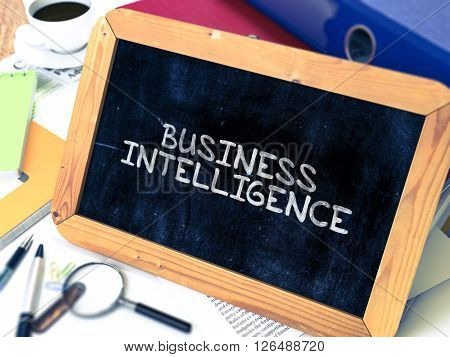 Business Intelligence Concept Hand Drawn on Chalkboard on Working Table Background. Blurred Background. Toned Image. 3D Render.