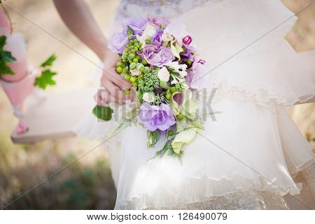 Bride with beautiful wedding bouquet  in hand closeup