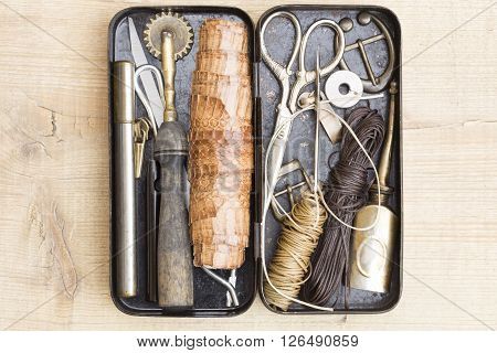 Leather craft tools in the vintage metal box