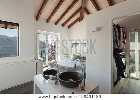 Interior of a loft, bedroom with bath, modern design