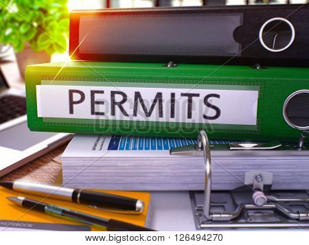 Permits - Green Office Folder on Background of Working Table with Stationery and Laptop. Permits Business Concept on Blurred Background. Permits Toned Image. 3D.