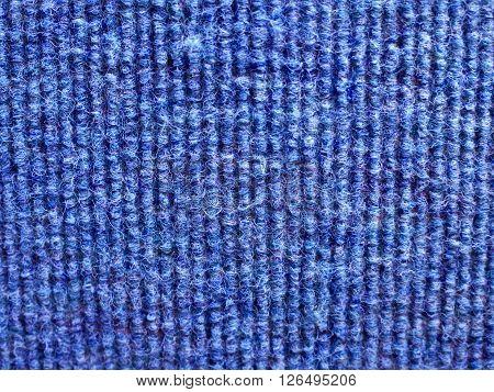 Corduroy canvas texture of a bus seat.Blue.