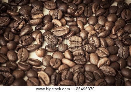 Coffee beans on a table as a background