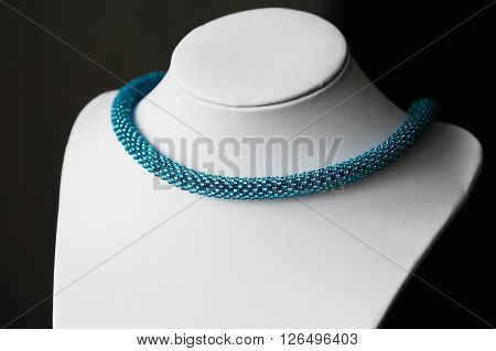 Beaded crochet necklace from turquoise seed beads close up