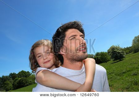 Man carrying a girl on his back