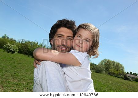 Man carrying a girl in his arms