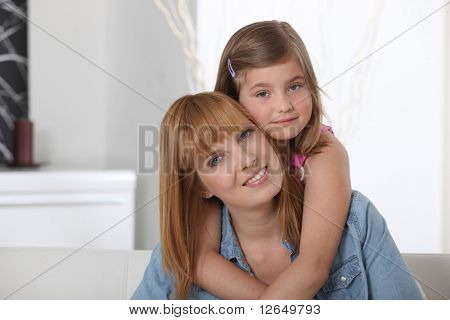 Portrait of a woman and a girl smiling
