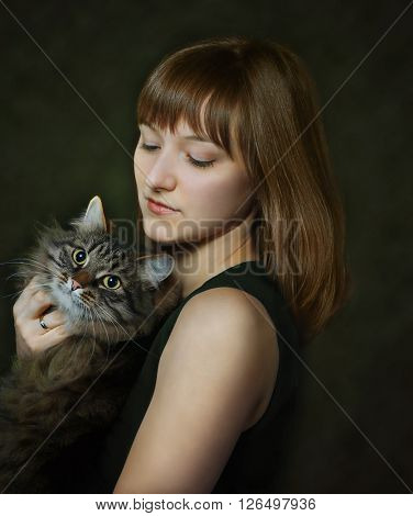 portrait of young woman with cat on dark background