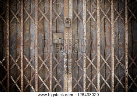 The Old Locked Foldable Rusted Steel Door