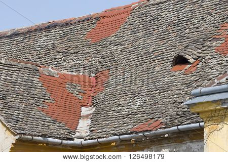 Historic Old Roof Fixed with New Tiles