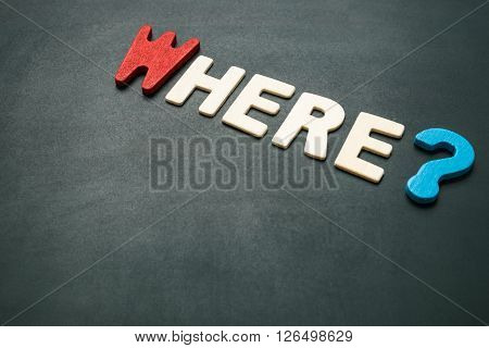 Text 'where' wording on blackboard - concept of 5 Ws questions - colorful alphabet made from wood