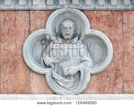 BOLOGNA, ITALY - JUNE 04: Saint Dominic by Paolo di Bonaiuto relief on facade of the San Petronio Basilica in Bologna, Italy, on June 04, 2015