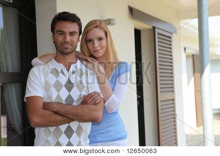Portrait of a couple visiting a home