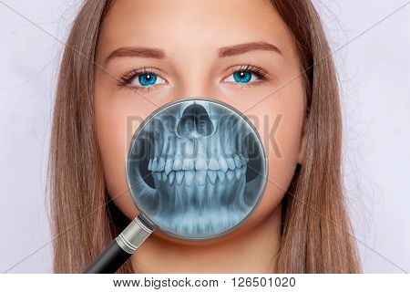 Radiograph of face, dentistry with a magnifying glass
