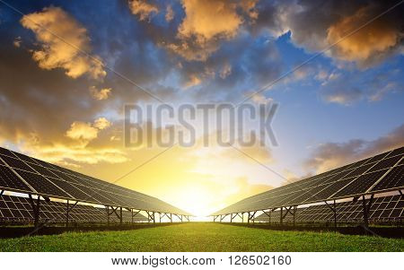 Solar energy panels against sunset sky. Clean energy.