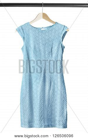 Beautiful lacy blue dress on clothes rack isolated over white