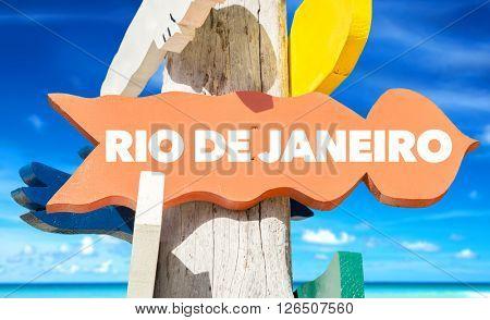 Rio de Janeiro signpost with beach background
